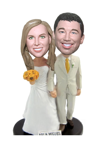 Custom Groom holding bride's hand bobbleheads